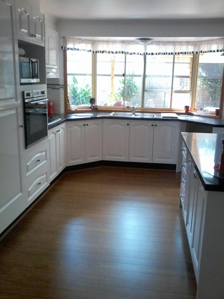 The Same Kitchen redesigned with a stone counter